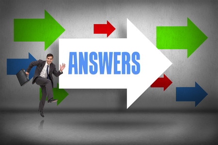 The word answers and happy businessman in a hury against arrows pointing photo