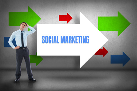 The word social marketing and thoughtful businessman with hand on head against arrows pointing photo