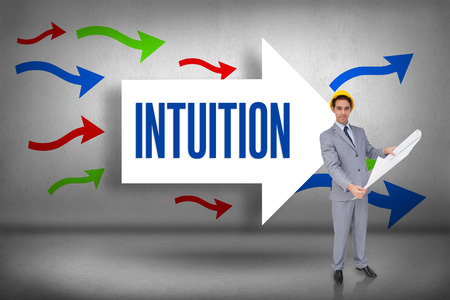 intuition: The word intuition and serious architect with hard hat holding plans against arrows pointing