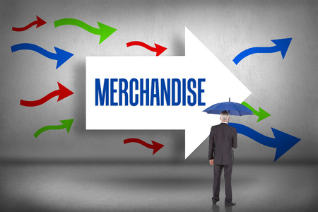 The word merchandise and businessman holding umbrella against arrows pointing Stock Photo - 26780711
