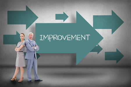 The word improvement and serious businessman standing back-to-back with a woman against blue arrows pointing photo