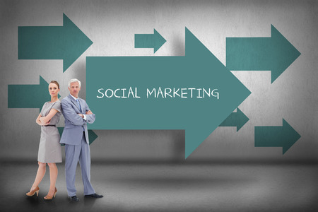 The word social marketing and serious businessman standing back-to-back with a woman against blue arrows pointing photo