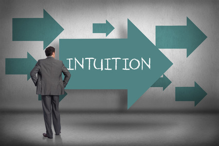 intuition: The word intuition and businessman with hands on hips against blue arrows pointing
