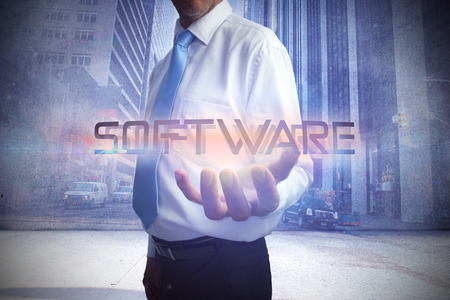 Businessman presenting the word software against urban projection on wall photo