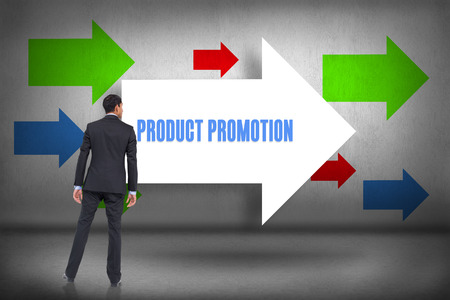 The word product promotion and asian businessman against arrows pointing photo