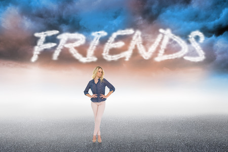 The word friends and thoughtful gorgeous blonde wearing classy clothes posing against cloudy landscape background photo