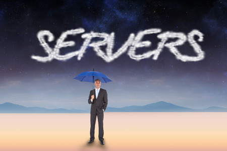 The word servers and businessman smiling at camera and holding blue umbrella against serene landscape photo