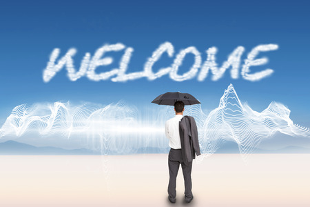 The word welcome and businessman standing back to camera holding umbrella and jacket on shoulder against energy design over landscape photo