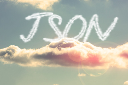 The word json against bright blue sky with cloud Stock Photo