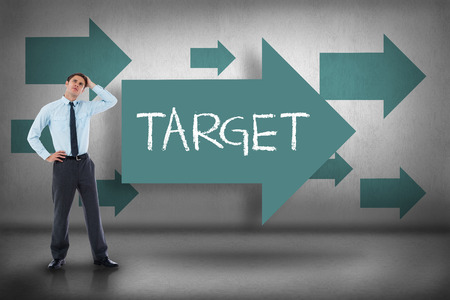 The word target and thoughtful businessman with hand on head against blue arrows pointing photo