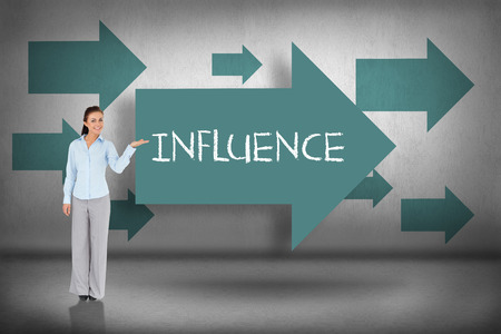 The word influence and businesswoman presenting against blue arrows pointing Stockfoto