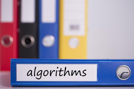 algorithms: The word algorithms on blue business binder Stock Photo