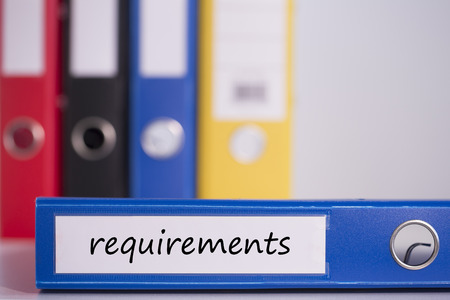requirements: The word requirements on blue business binder