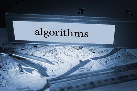 algorithms: The word algorithms on blue business binder on a desk
