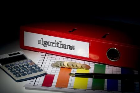 algorithms: The word algorithms on red business binder on a desk