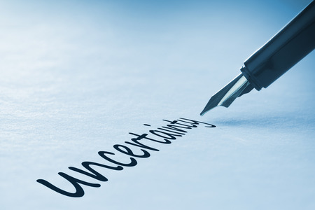 unknowing: Fountain pen writing the word uncertainty Stock Photo