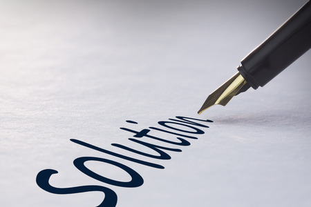 fountain pen writing: Fountain pen writing the word solution Stock Photo