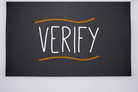 verify: The word verify written on big blackboard Archivio Fotografico