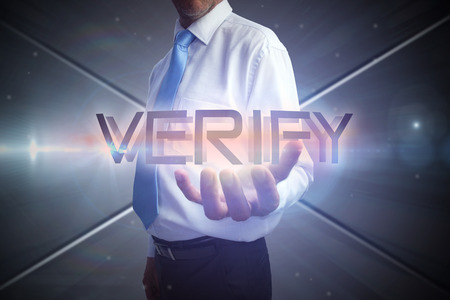 Businessman presenting the word verify against futuristic screen with lines