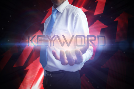 Businessman presenting the word keyword against shiny red arrows on black background Stock Photo - 26802337