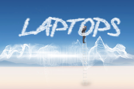 The word laptops and businessman standing on ladder using binoculars against energy design over landscape photo