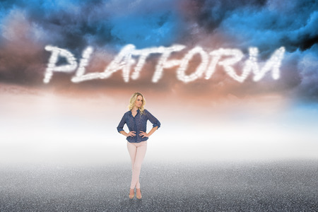 The word platform and thoughtful gorgeous blonde wearing classy clothes posing against cloudy landscape background photo