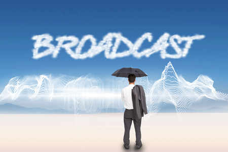 The word broadcast and businessman standing back to camera holding umbrella and jacket on shoulder against energy design over landscape photo