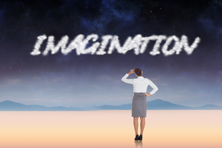 The word imagination and businesswoman scratching her head against serene landscape photo
