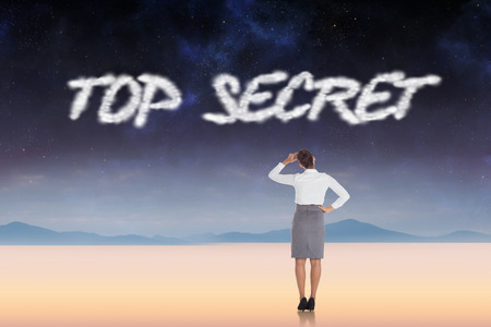 The word top secret and businesswoman scratching her head against serene landscape photo