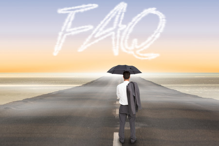 The word faq and businessman standing back to camera holding umbrella and jacket on shoulder against road leading out to the horizon photo