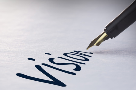 Fountain pen writing the word vision photo