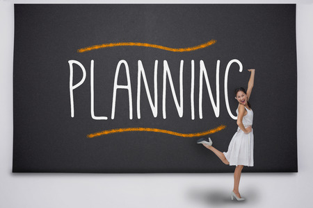 Pretty asian woman against the word planning photo