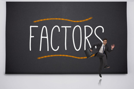 Happy businessman jumping against the word factors photo