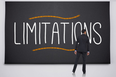 limitations: Businessman reading the word limitations