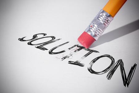 erasing: Pencil erasing the word solution on paper