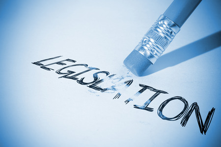 legislation: Pencil erasing the word legislation on paper