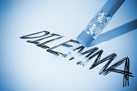 erasing: Pencil erasing the word dilemma on paper
