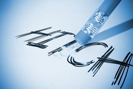erasing: Pencil erasing the word hitch on paper Stock Photo