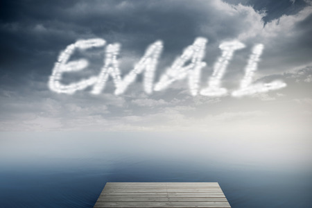 The word email against cloudy sky over ocean photo