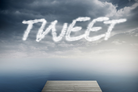 The word tweet against cloudy sky over ocean Stock Photo - 26804901