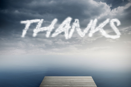 The word thanks against cloudy sky over ocean