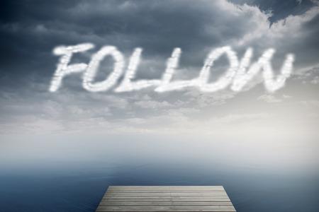 The word follow against cloudy sky over ocean