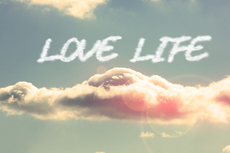 love of life: The word love life against bright blue sky with cloud Archivio Fotografico