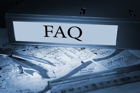 The word faq on blue business binder on a desk photo