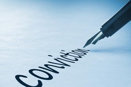 conviction: Fountain pen writing the word conviction Stock Photo
