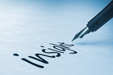 intuition: Fountain pen writing the word insight Stock Photo
