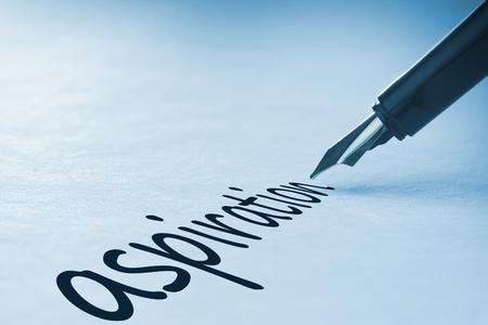 Fountain pen writing the word aspiration