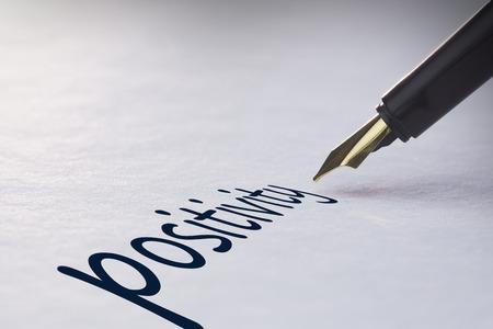 positivity: Fountain pen writing the word positivity