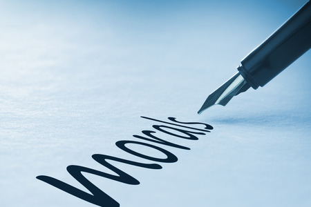 morals: Fountain pen writing the word morals Stock Photo