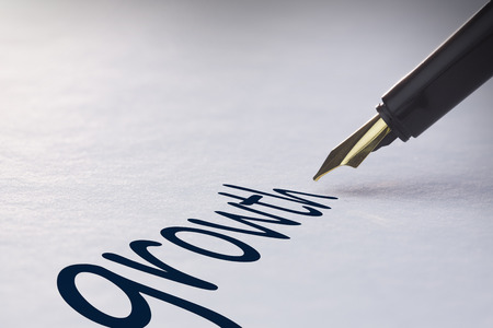 fountain pen writing: Fountain pen writing the word growth Stock Photo